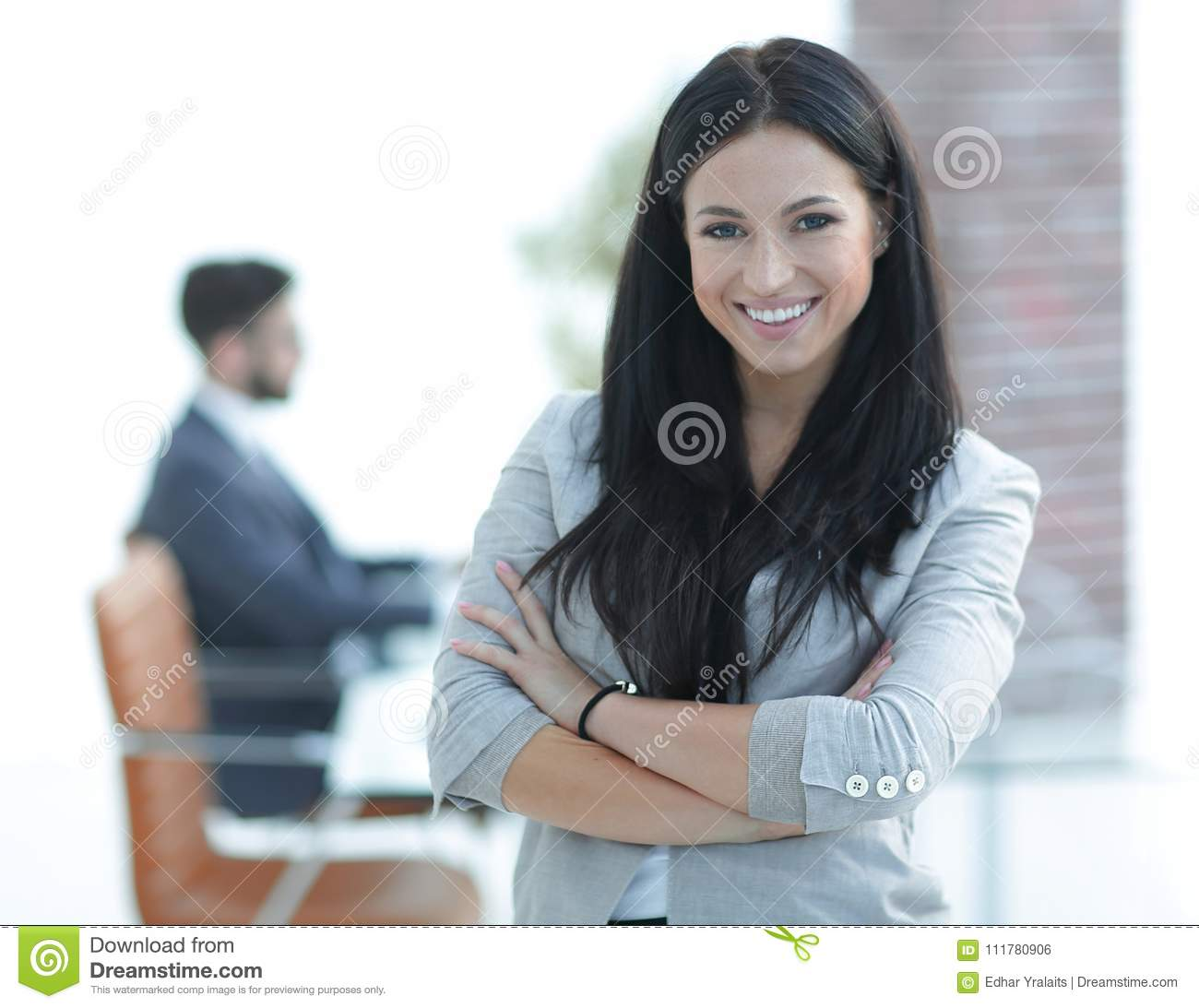 Successful young business woman on the office background