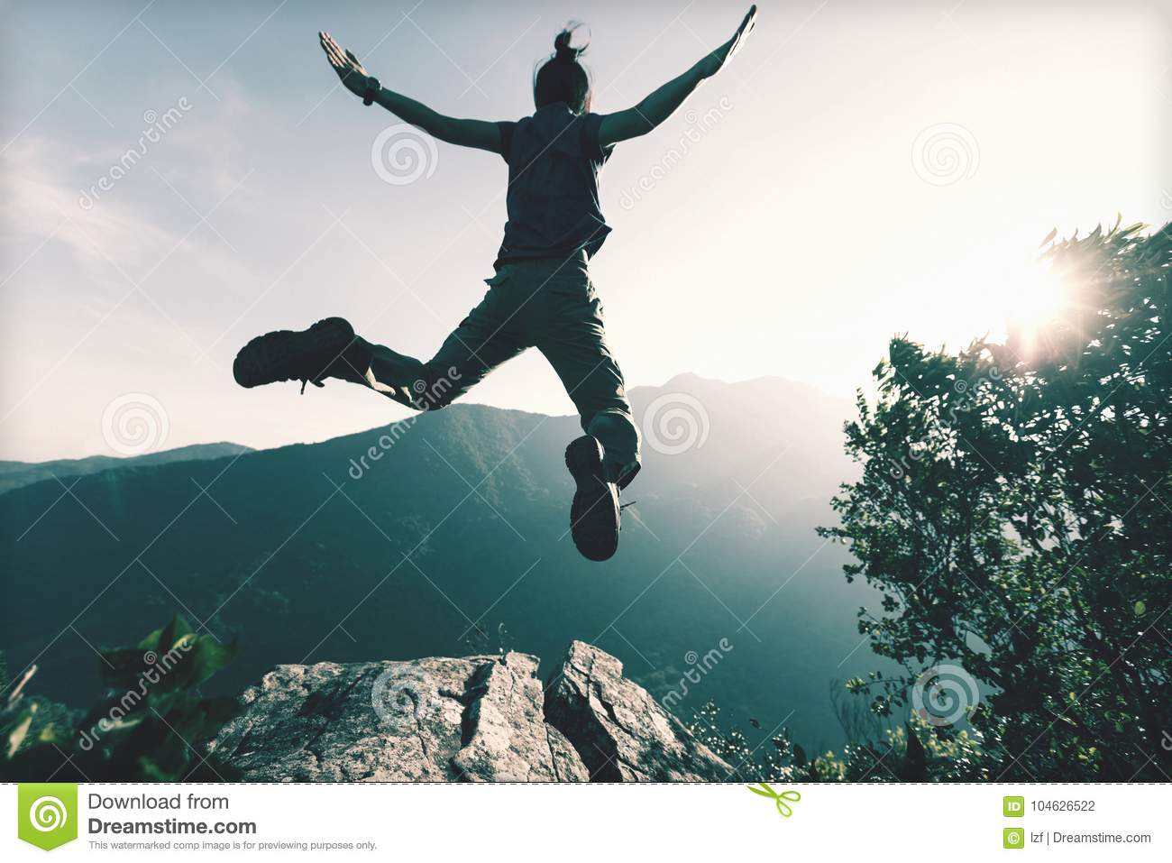 Successful Young Woman Jumping Stock Photo - Image of