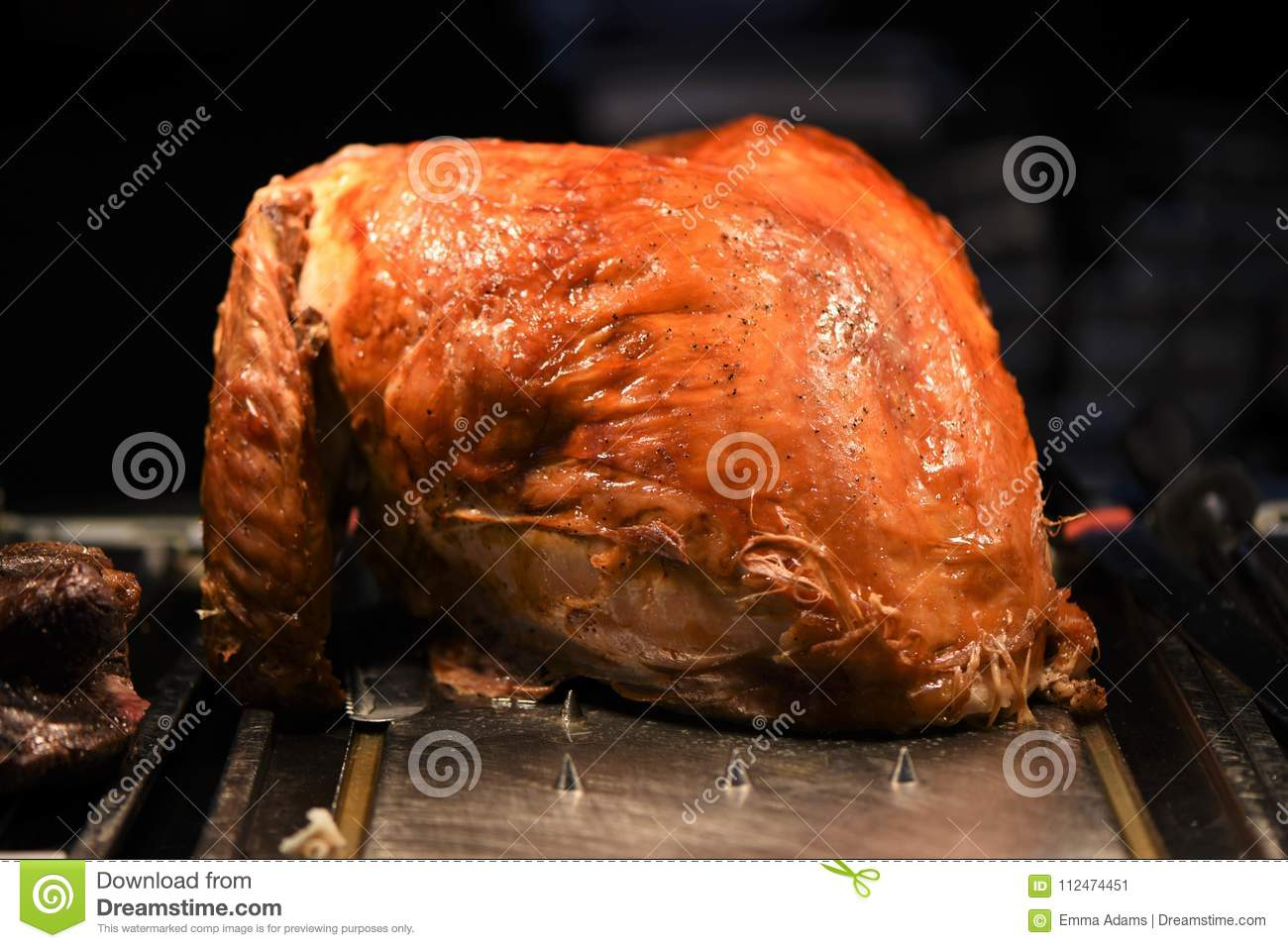 Succulent golden whole roast turkey joint of meat resting and ready to carve