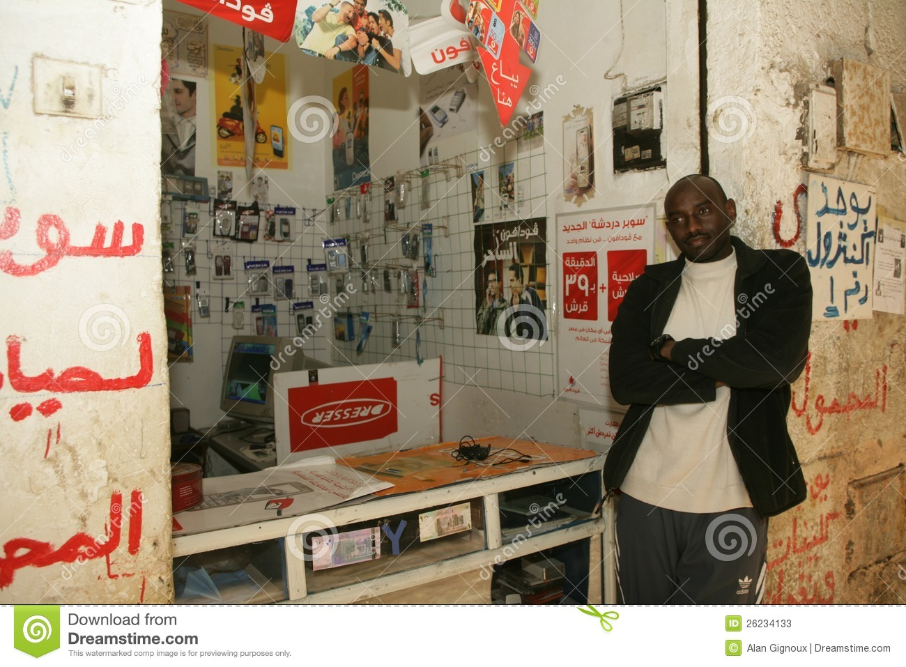 A Sudanese Refugee In His Mobile Phone Accessories Shop