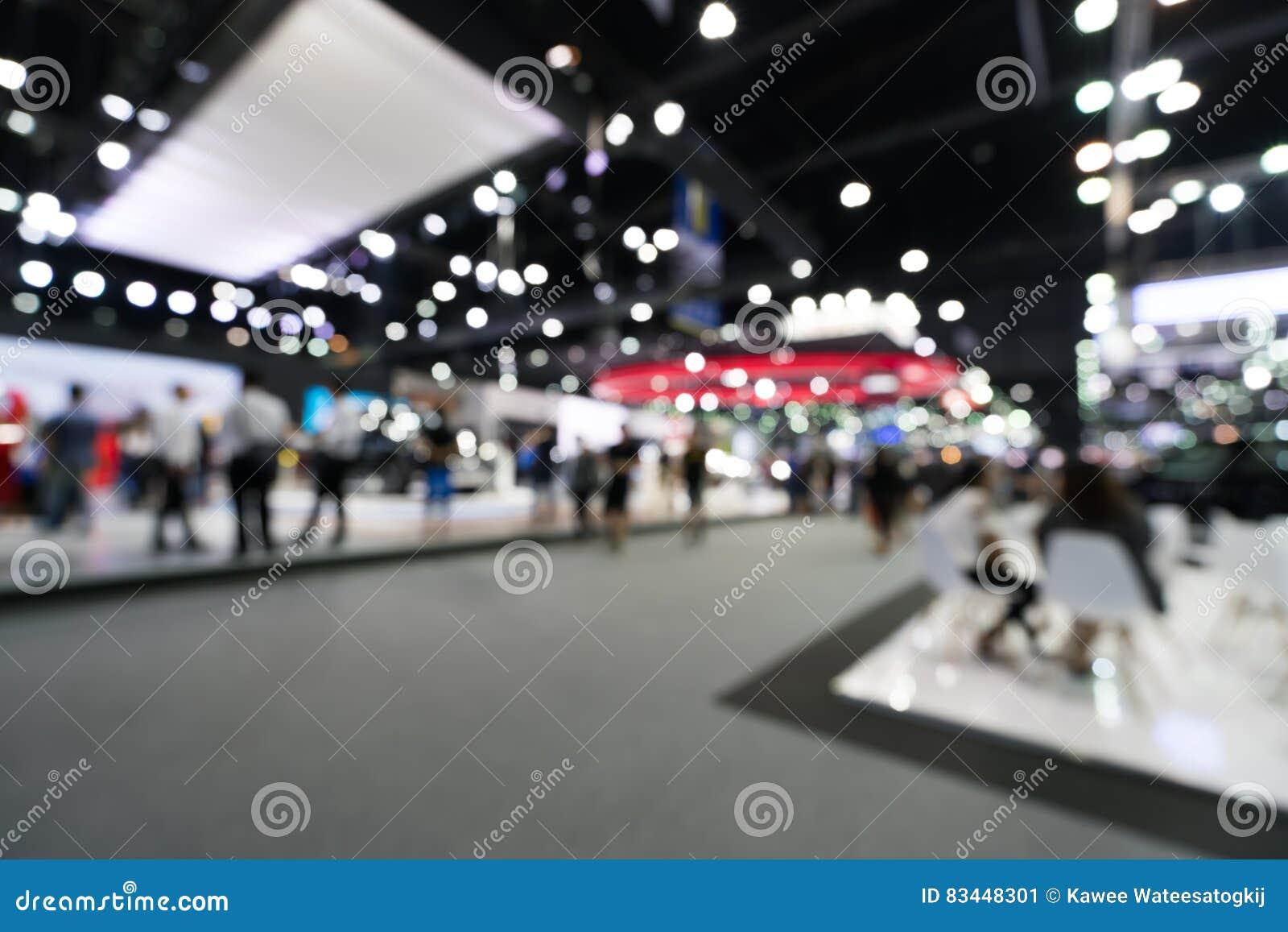 Suddig defocused bakgrund av den offentliga händelsemässhallen, begrepp för affärshandelshow