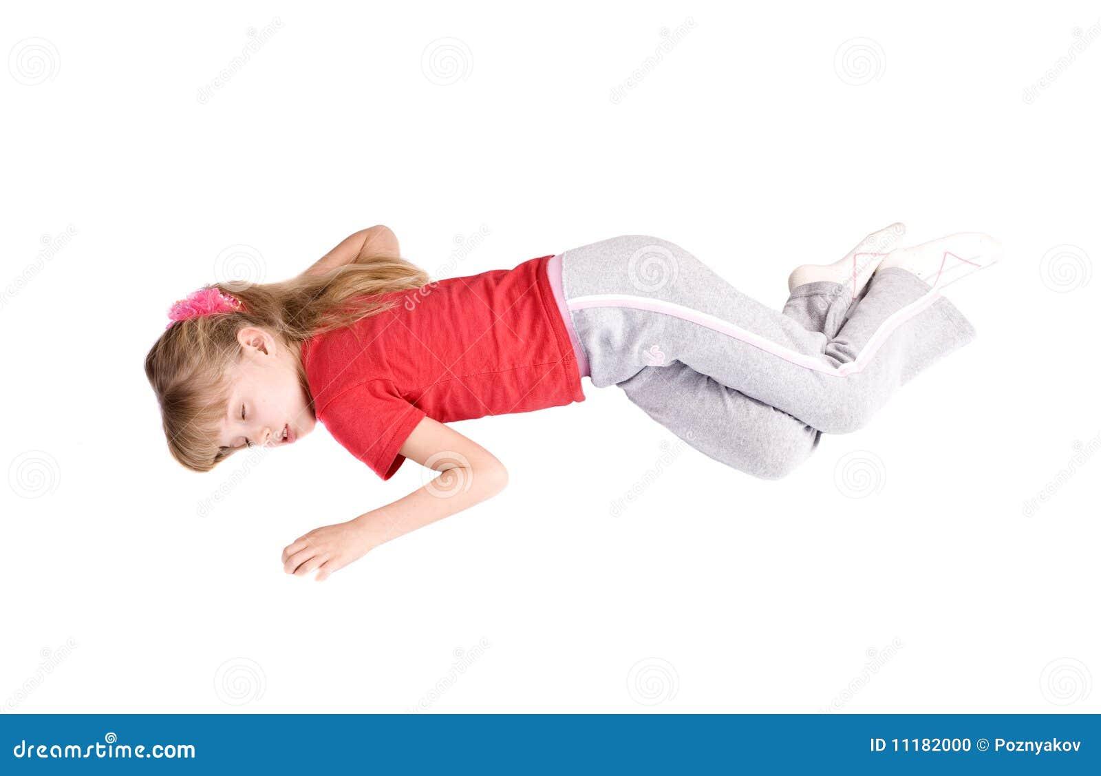Sueño del niño de la muchacha en suelo.