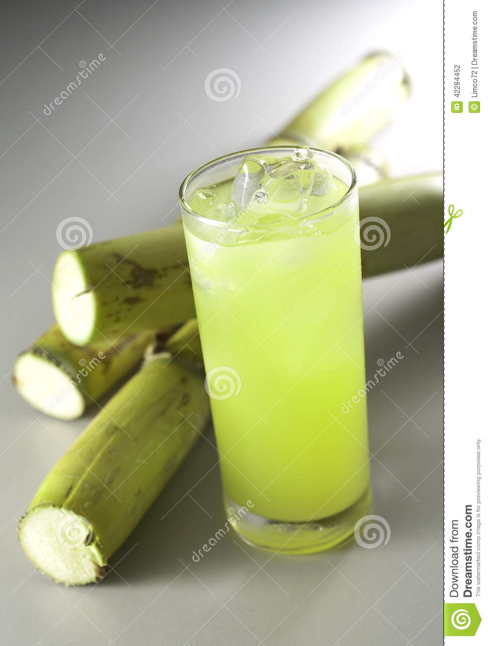 Stock photography sugar cane juice surrounded by sugar cane image