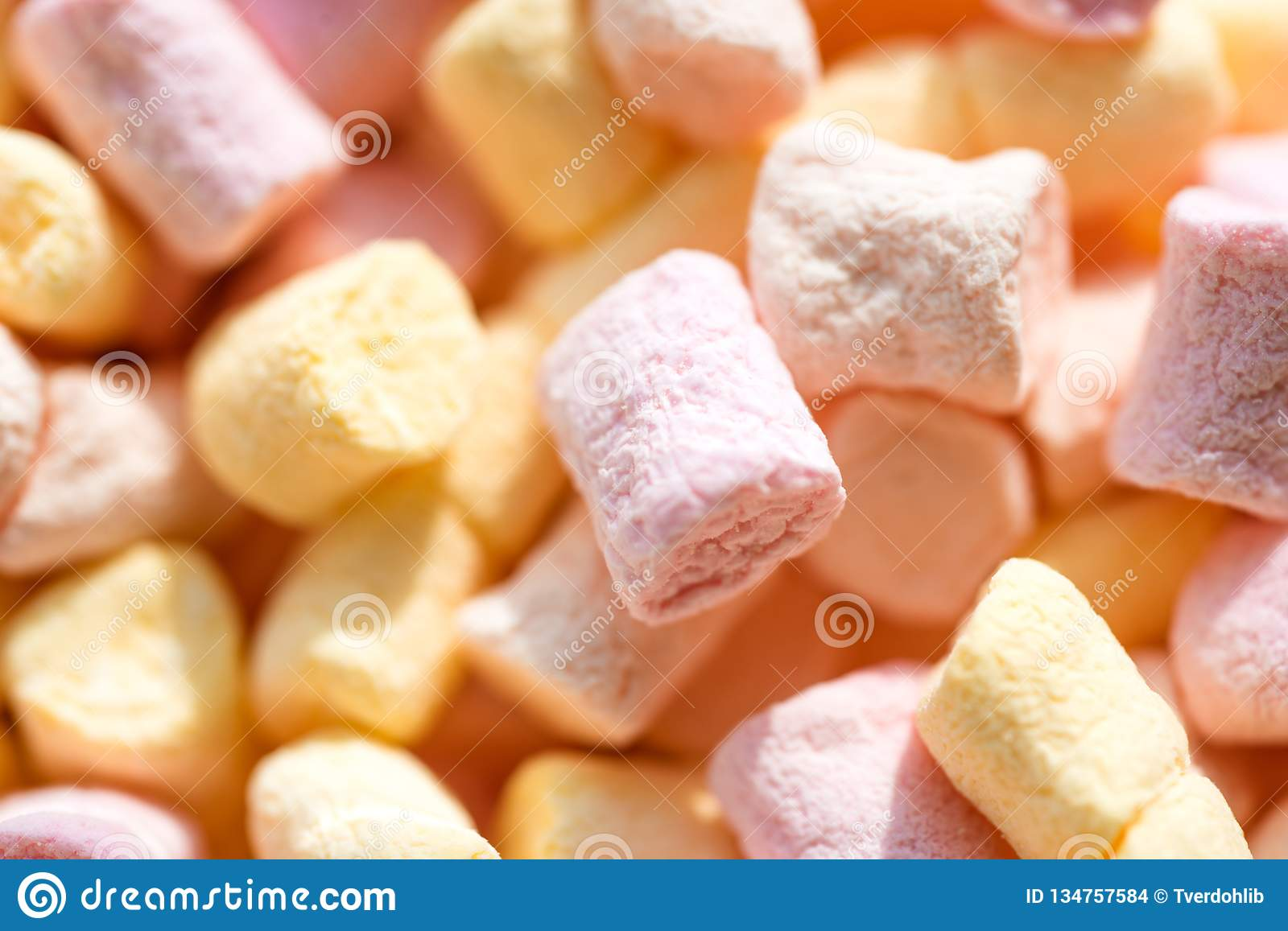 Sugar confectionery. Marshmallow souffle with sweet flavor. Colorful mini marshmallow background or texture. Marshmallow