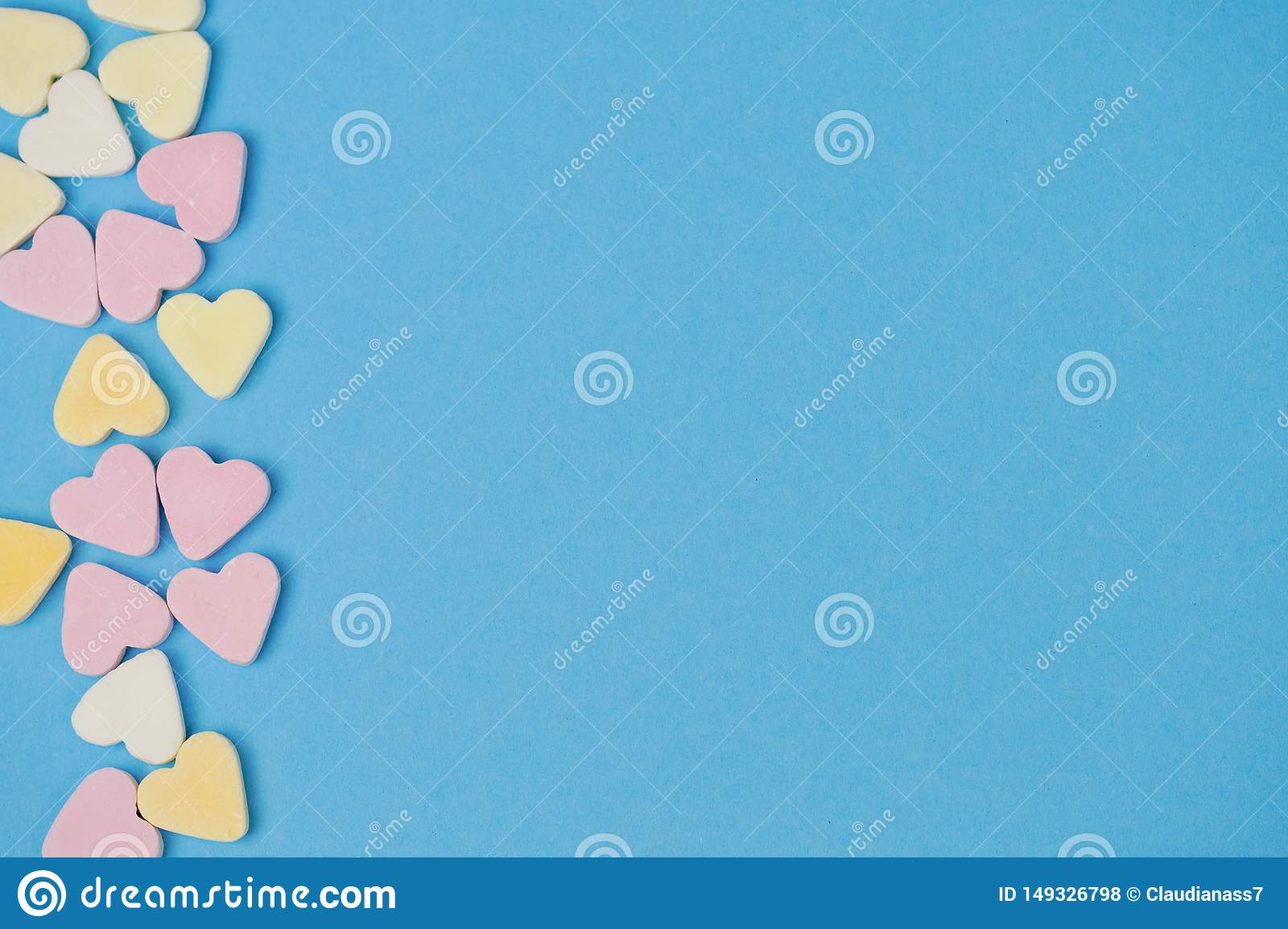 Sugar hearts on the left side on blue background for text