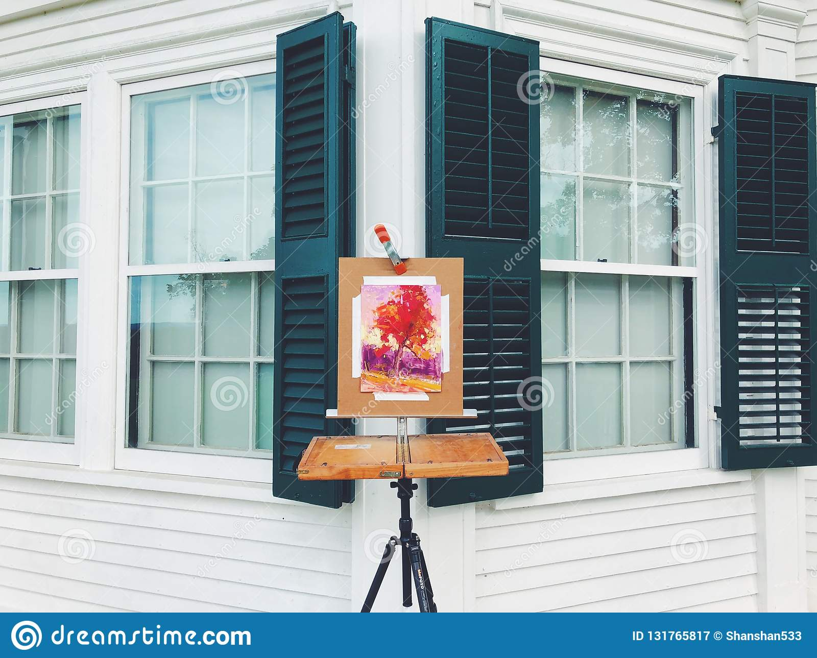 A sugar maple tree watercolor painting on the easel