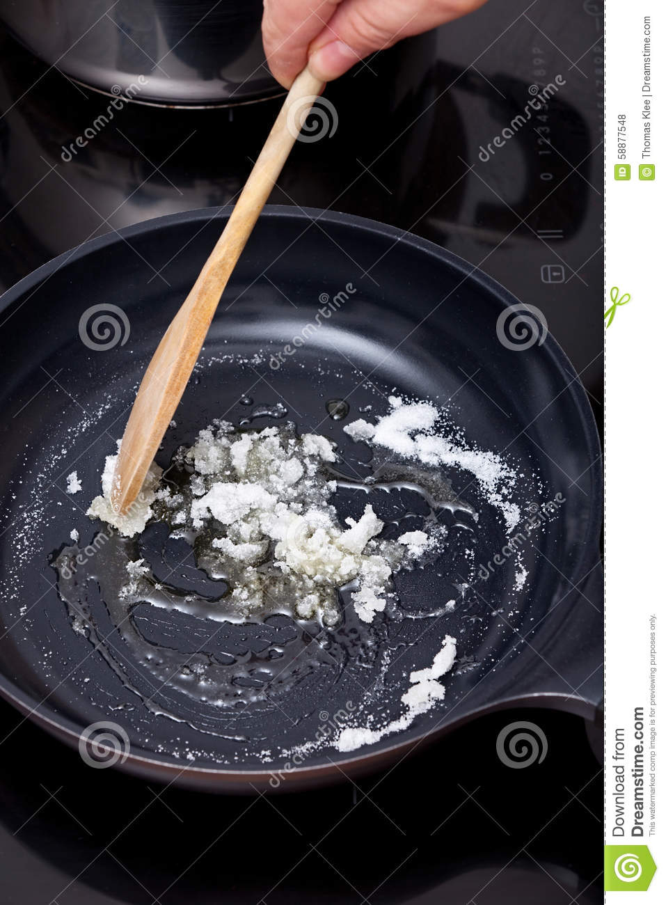 Sugar stir up with wooden spoon