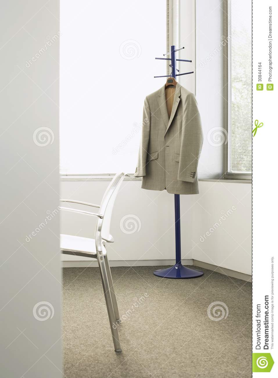Suit Jacket On Coat Stand In Corner Of Office Stock Photo ...