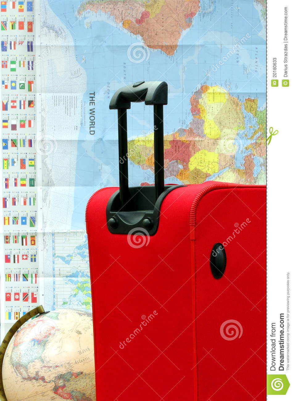 Ready to travel around the world luggage in the background of world