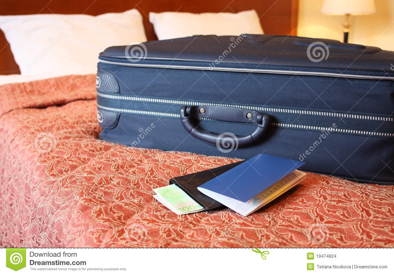 Suitcase passport and wallet stock images image 19474824 for Spa uniform suppliers cape town