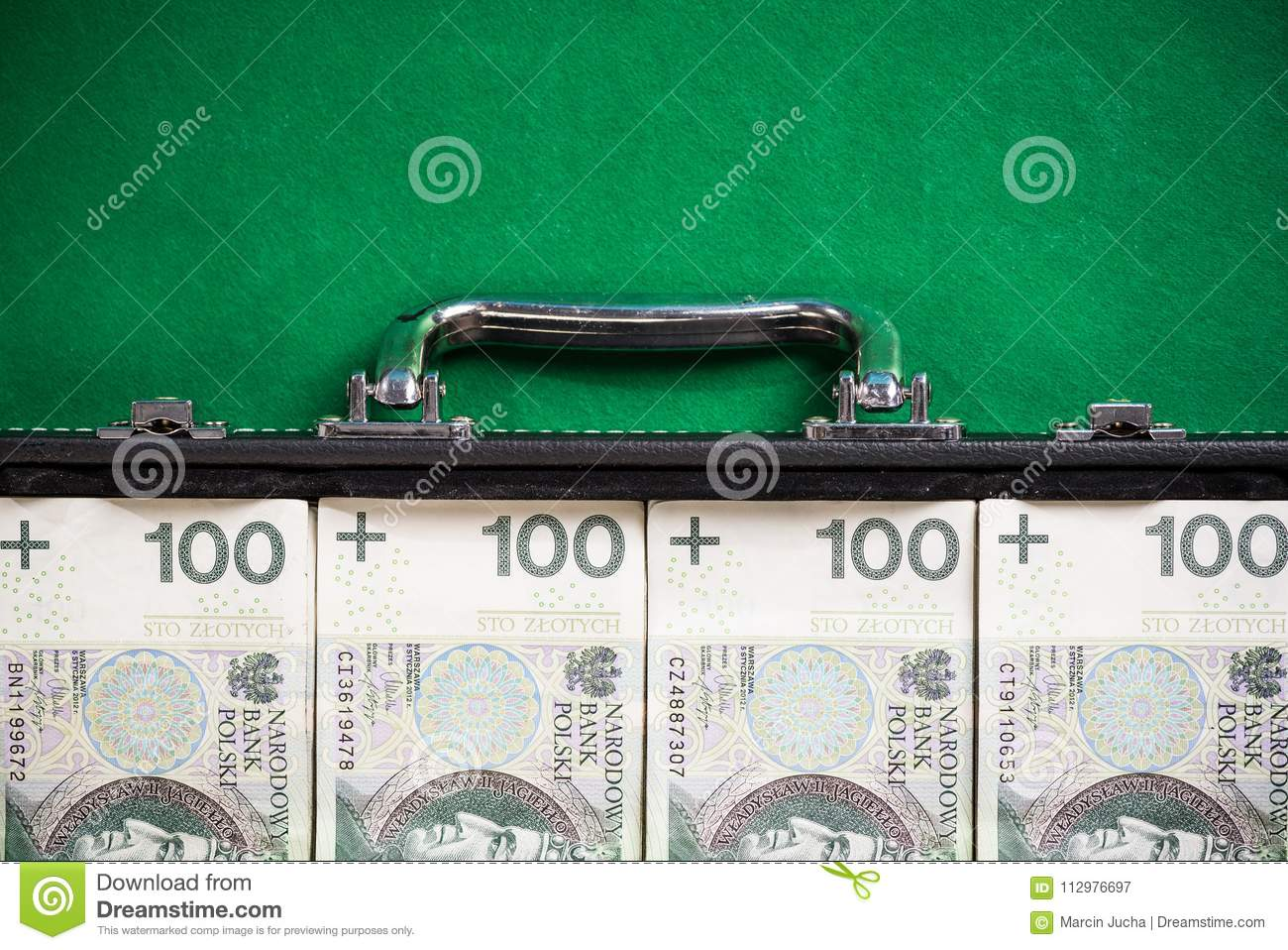 Suitcase with polish zloty , bribery and corruption concept