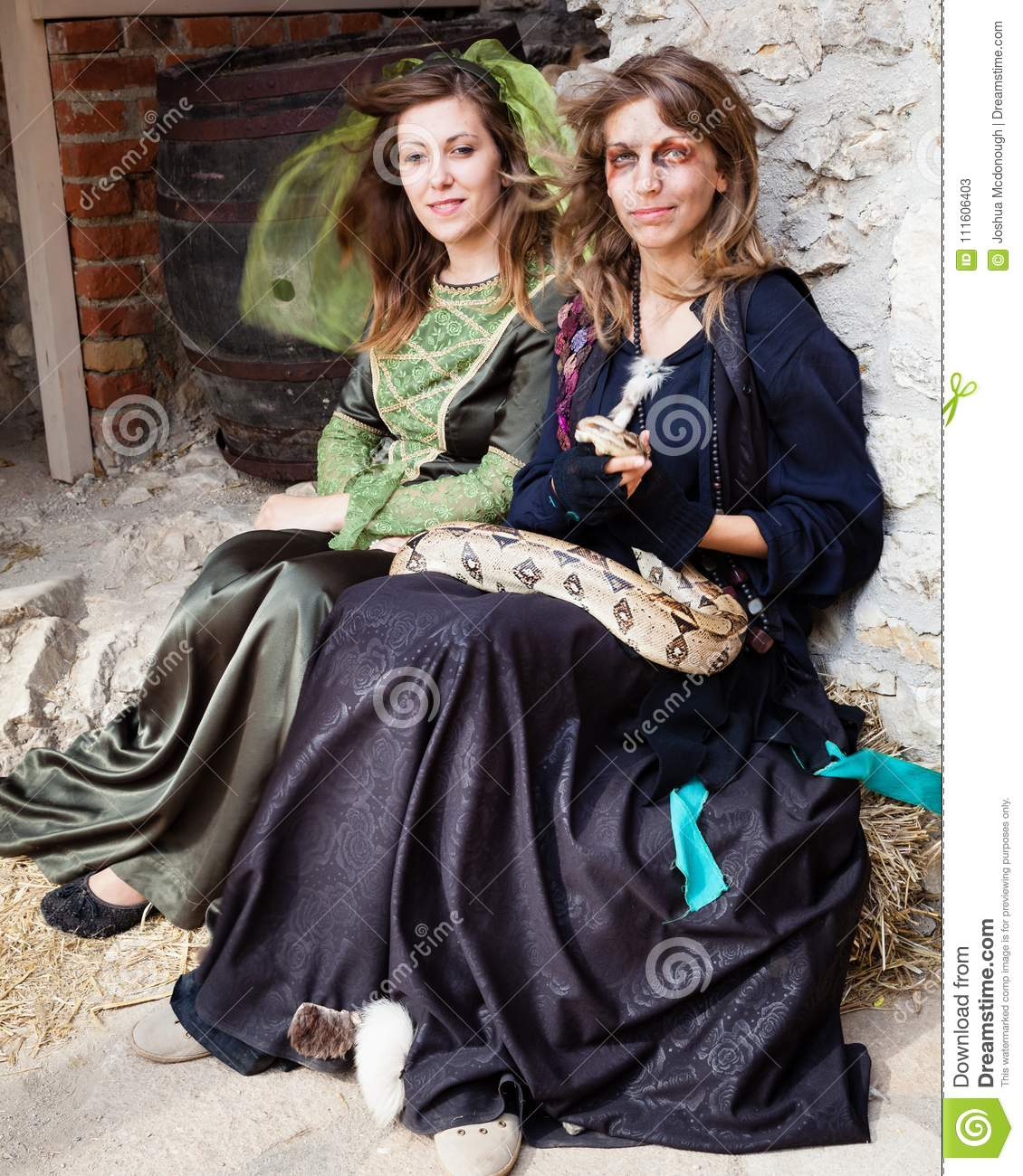 Girls in Middle Eval Clothes and Snake at Castle