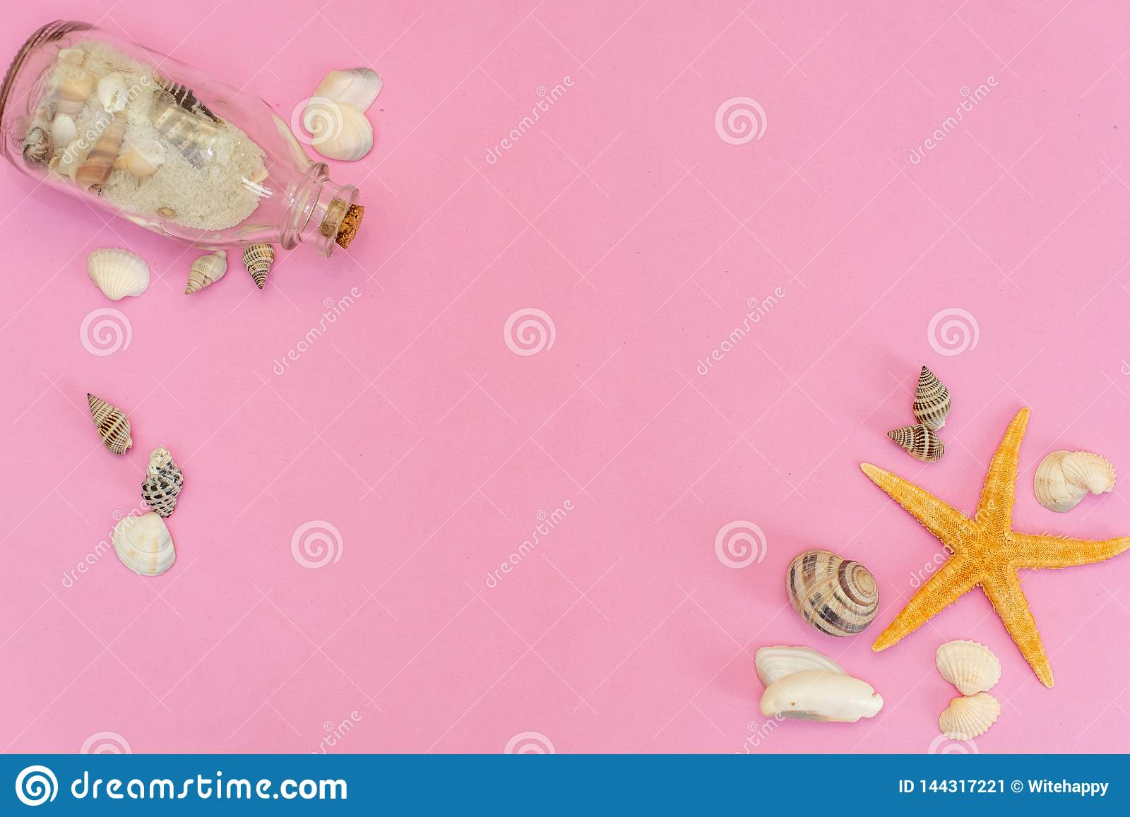 Starfish and seashells on pink background