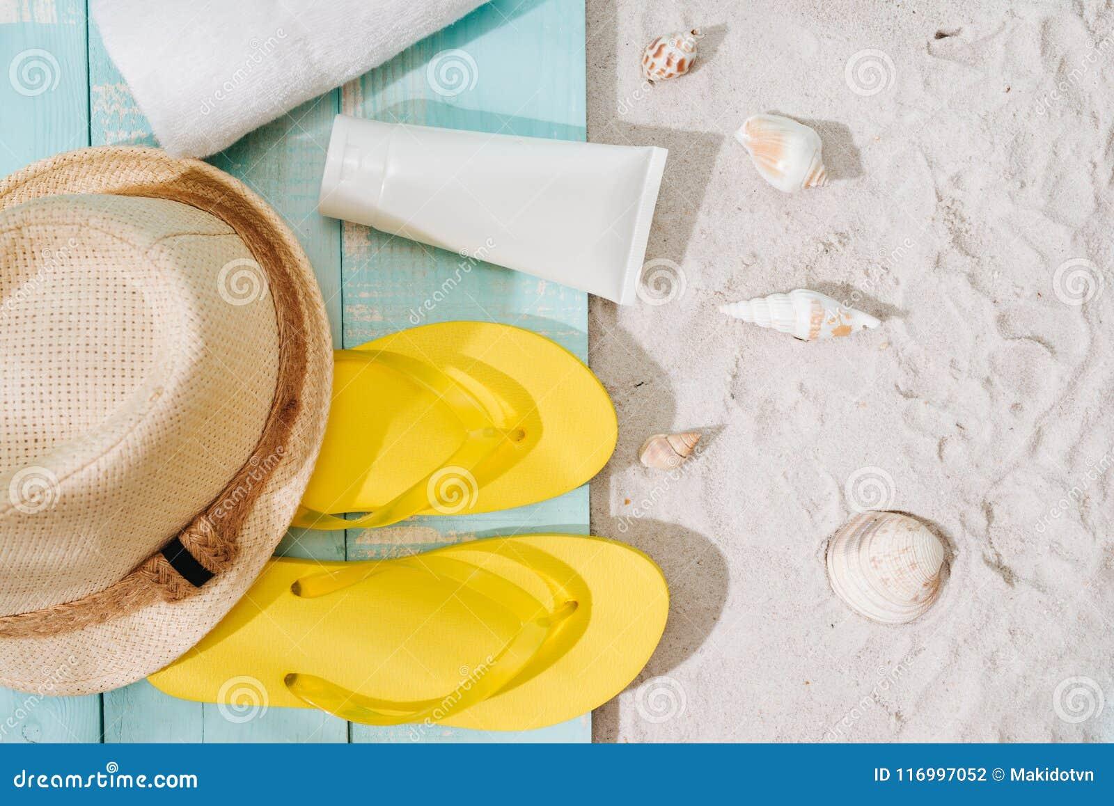 Summer background. Beach accessories flip flops, sunglasses, hat
