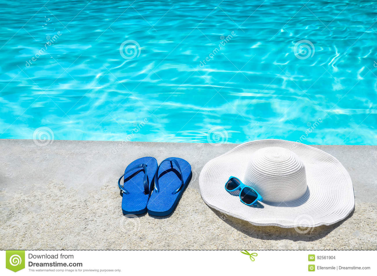 Summer background with hat, flip flops and sunglasses near the p