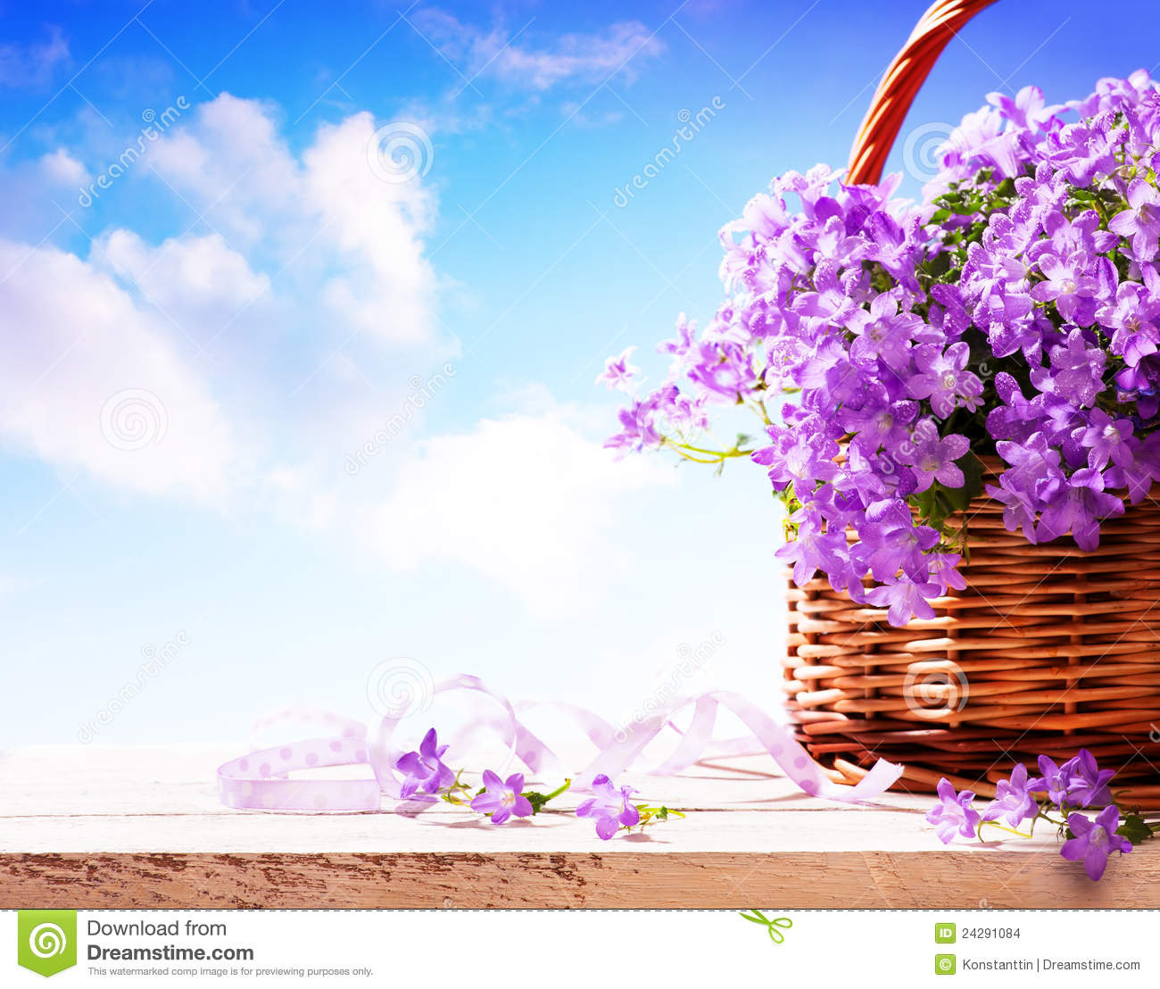 summer background  summer flowers in basket stock photo