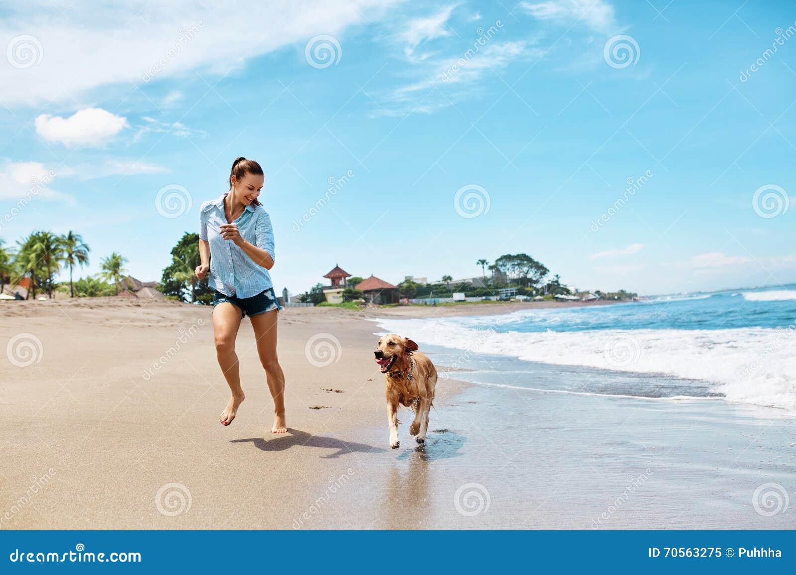 Summer Beach Fun. Woman Running With Dog. Holidays Vacations. Summer