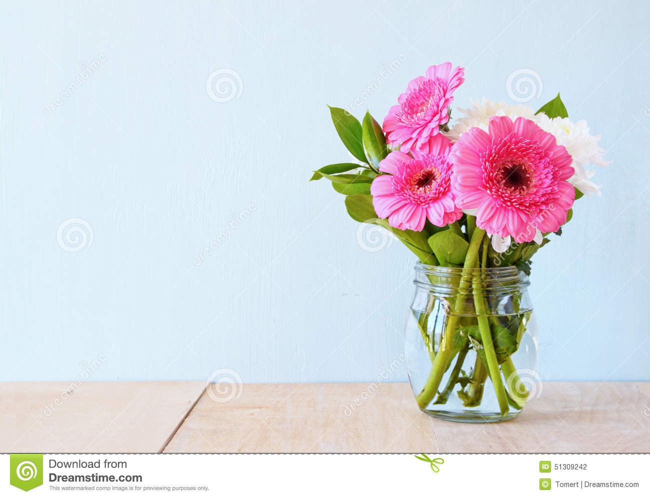 Summer bouquet of flowers on the wooden table with mint background summer bouquet of flowers on the wooden table with mint background vintage filtered image izmirmasajfo