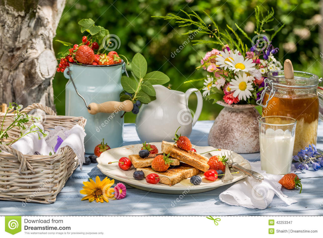 Summer breakfast in the garden stock photo image 42253347 for Cafe du jardin restaurant covent garden
