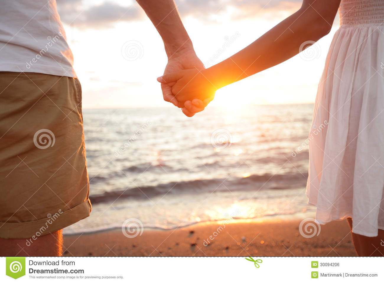 Summer Couple Holding Hands At Sunset On Beach Royalty ...
