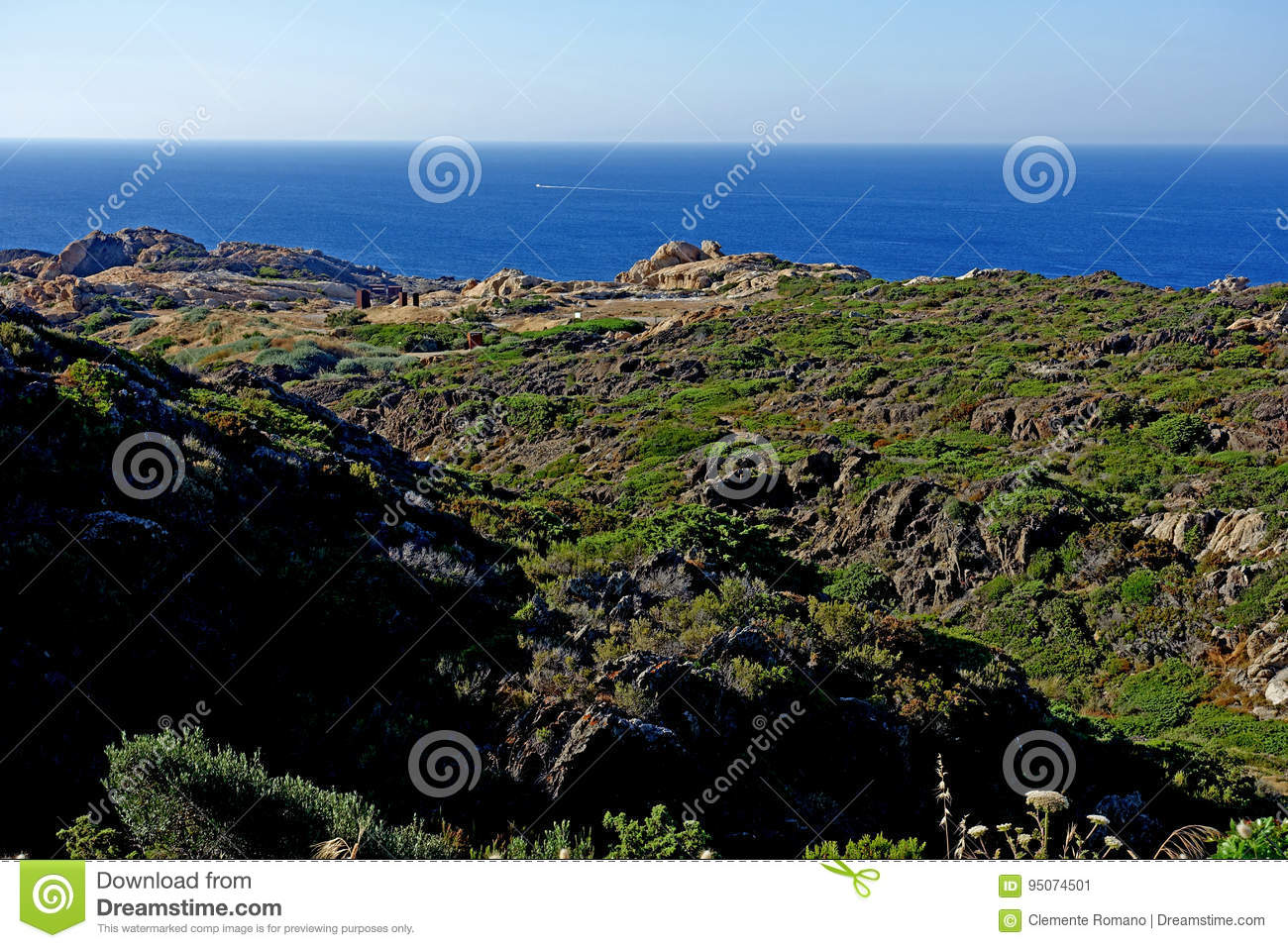 Summer: a cove cliff of cape of the Crosses in Spain with blue sea