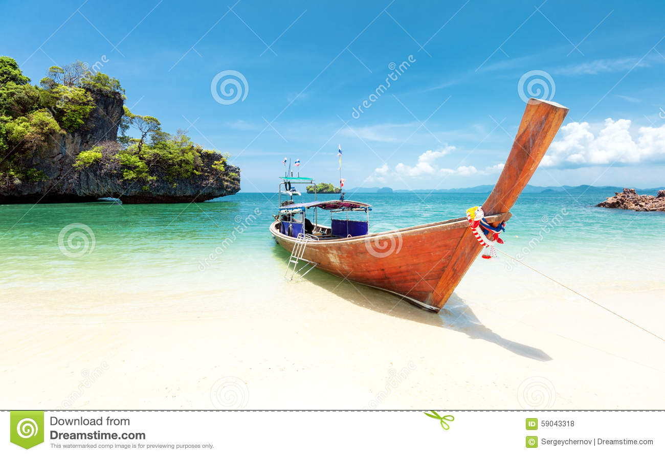 Summer day on exotic beach of tropical island. Thailand tourism