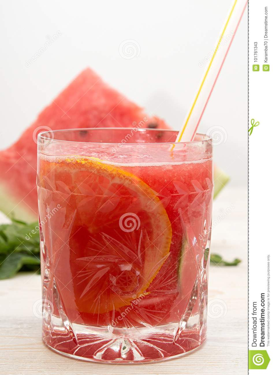 Summer drink watermelon smoothie juice in glass with cocktail tu