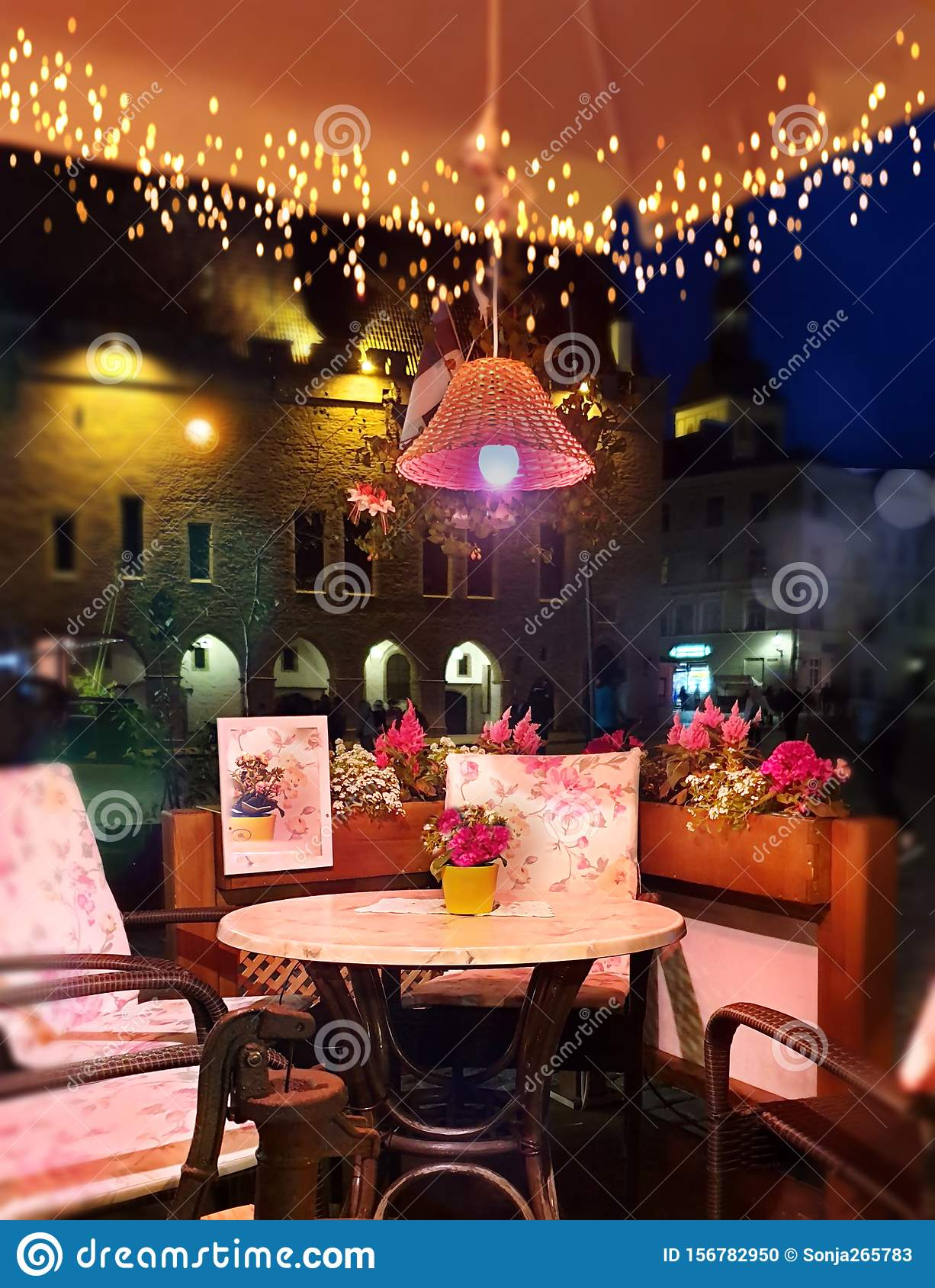 Summer Evening Lighting Illumination Street Cafe Decoration Table With Flowers On Top And Lamp Restaurant Outdoor In The City Rela Stock Photo Image Of Life Reflection 156782950