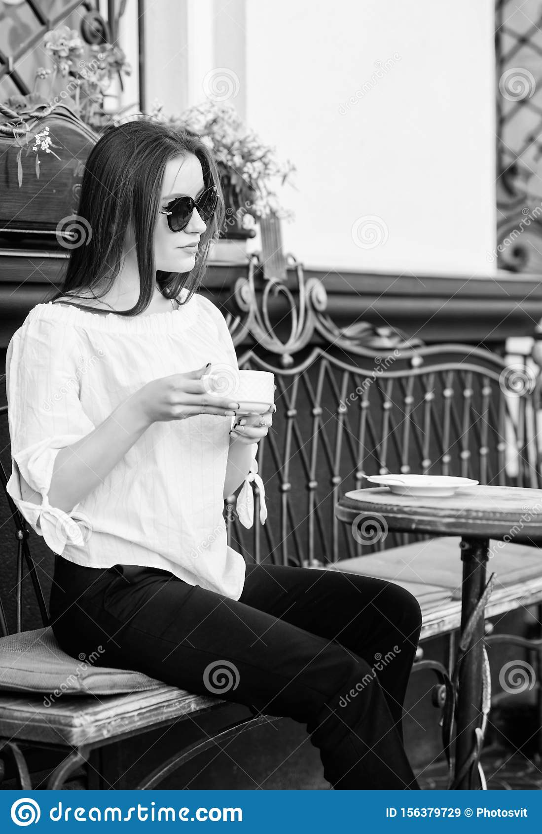 Summer fashion beauty. Meeting in cafe. girl relax in cafe. Business lunch. stylish woman in glasses drink coffee. good