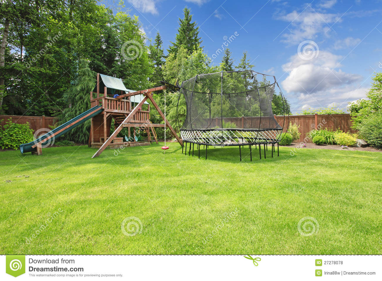 summer fenced backyard with play area royalty free stock