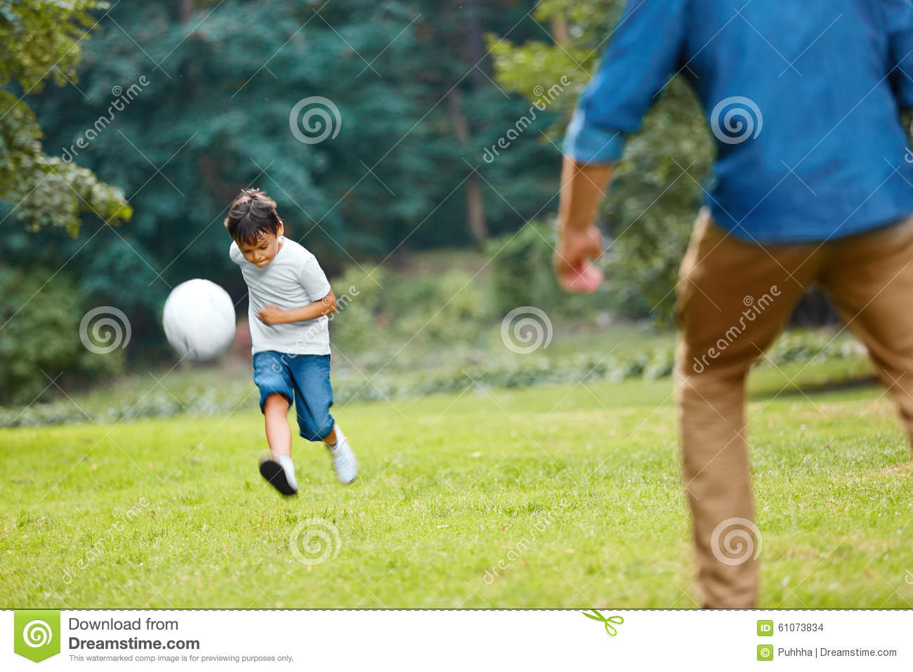 Summer Football. Dad And Son Playing Soccer. Stock Photo
