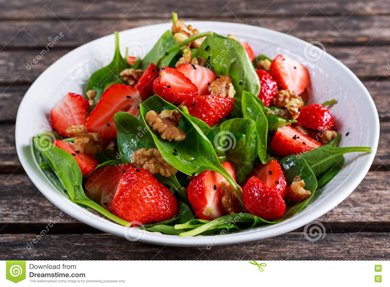 Summer Fruit Vegan Spinach Strawberry nuts Salad. concepts health food