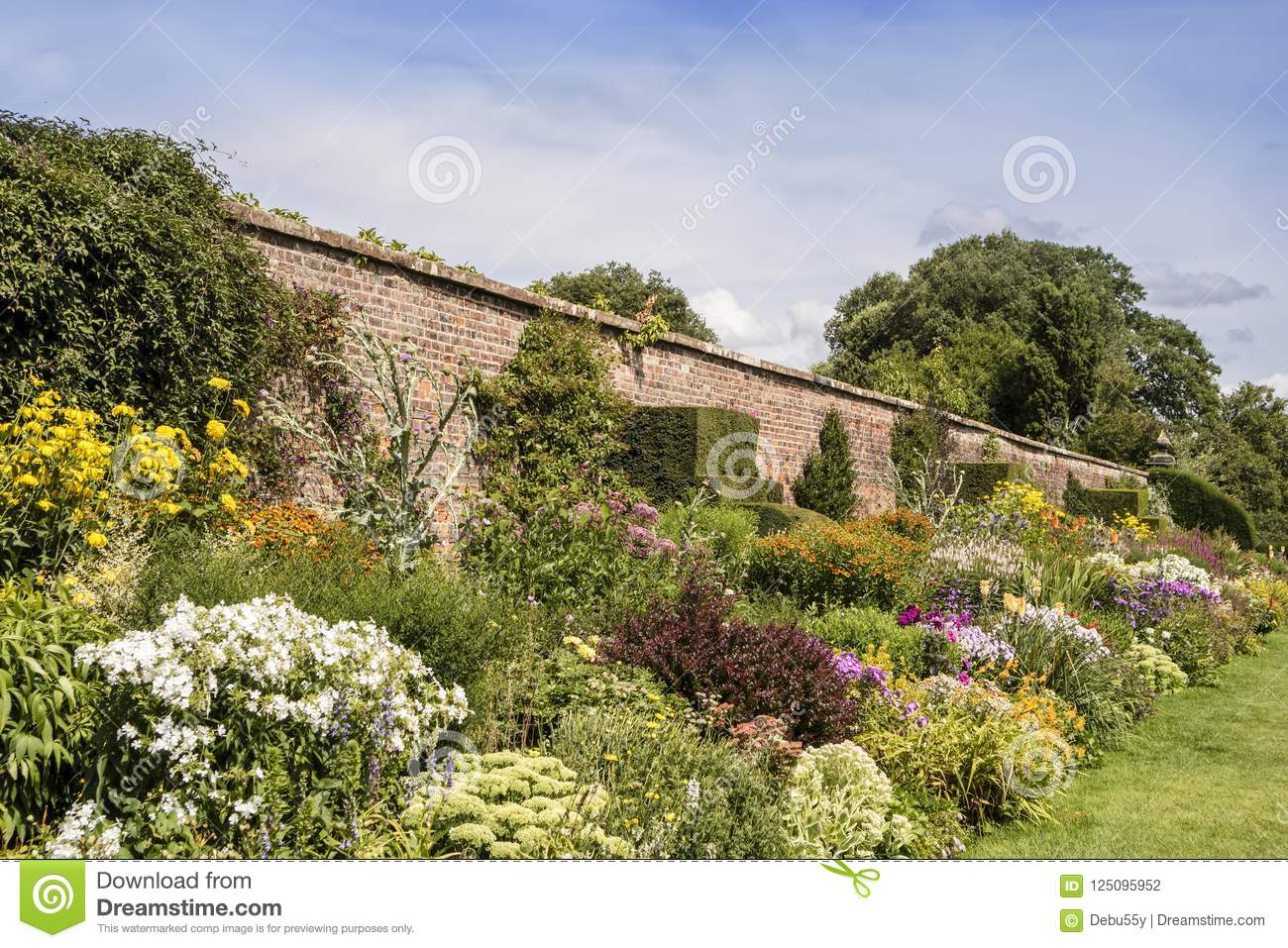 Summer Garden With Old Brick Wall Stock Photo Image Of Long