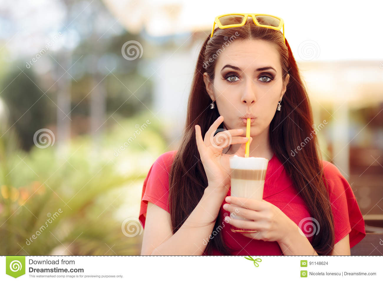 Summer Girl and Sipping Coffee Drink Trough a Straw