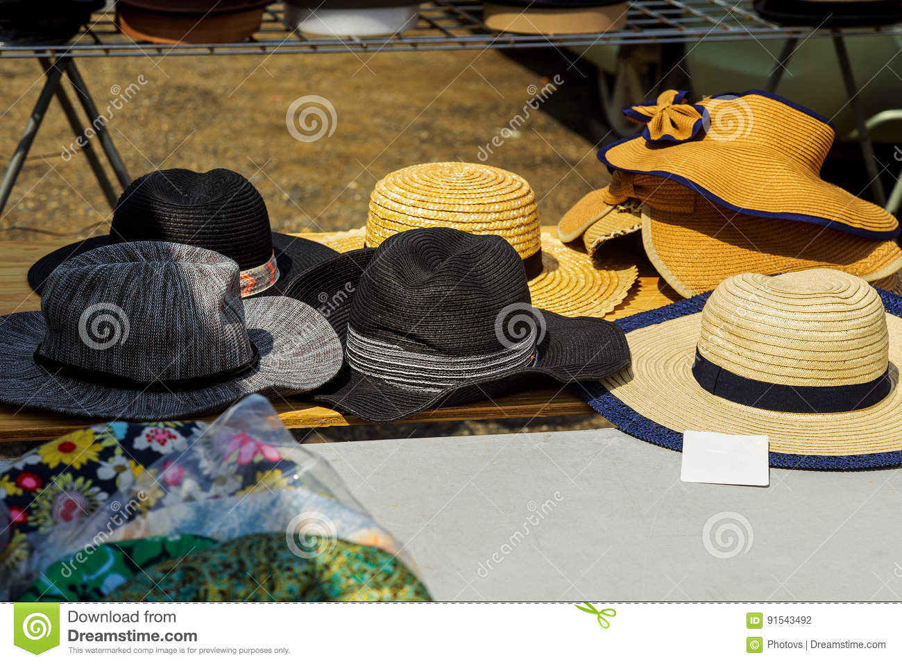 9733ac5624200 Summer hats for sale in a market stall outdoor. More similar stock images