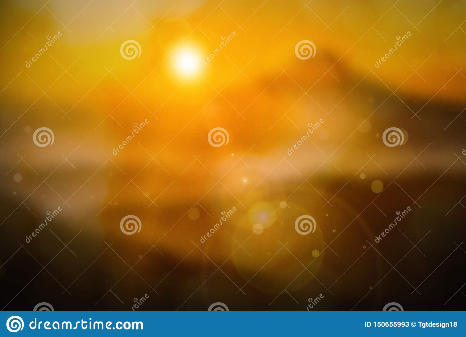 Summer holiday concept: sun light and abstract blur yellow background.