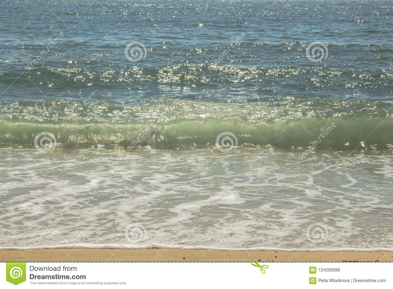 Summer mood. A glimpse of the beautiful waves rolling down to the shore.