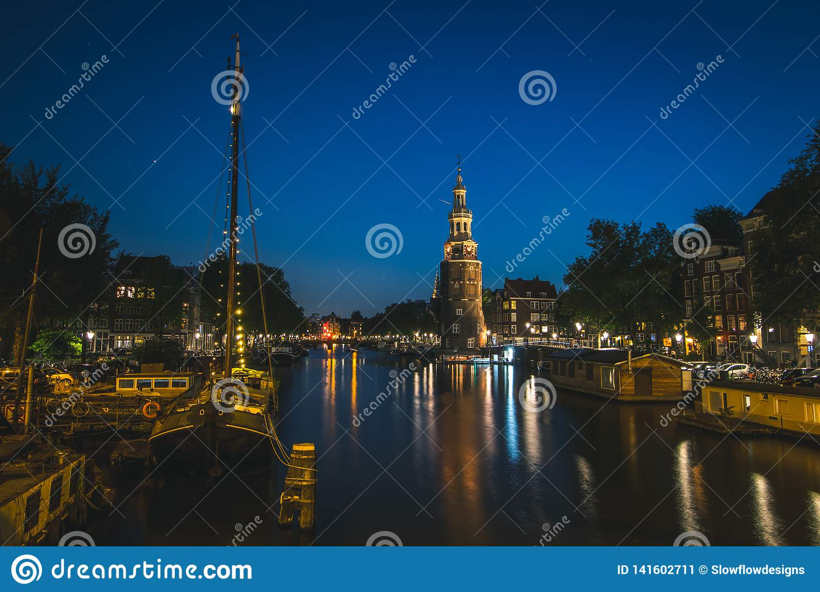 Entrance to canals and clock tower in Amsterdam, Netherlands