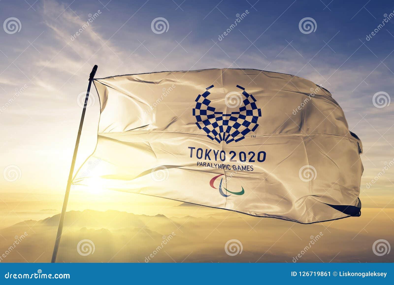 2020 Summer Paralympics Emblem flag textile cloth fabric waving on the top sunrise mist fog