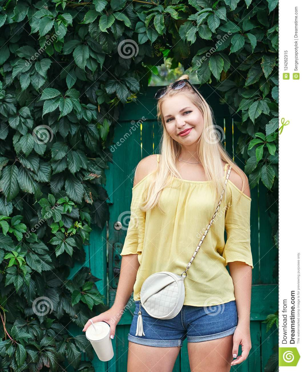 Outdoors Portrait Of Young Beautiful Blonde Woman With High Bun