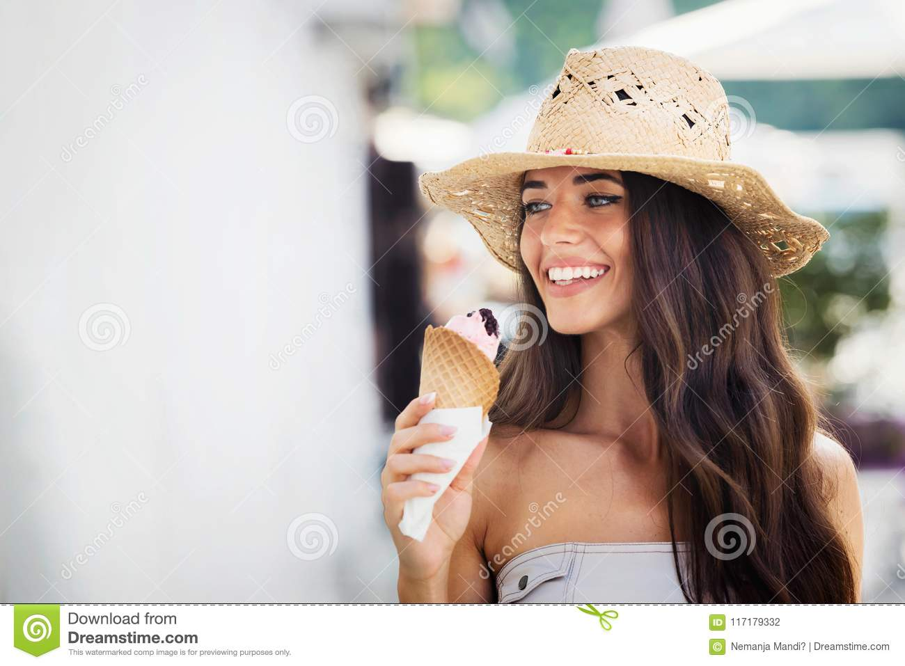 Summer portrait of beautiful woman with ice cream outdoors