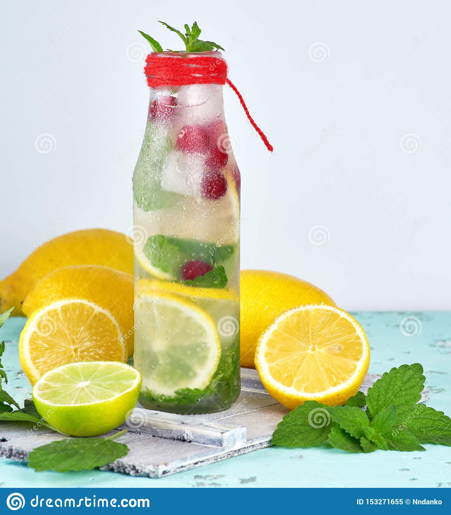 summer refreshing drink lemonade with lemons, cranberry, mint leaves