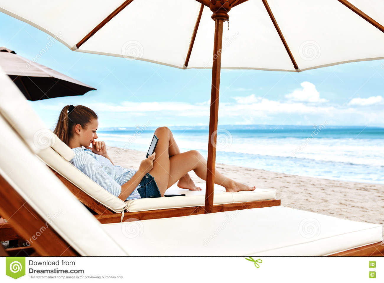 Summer Relaxation. Woman Reading, Relaxing On Beach. Summertime