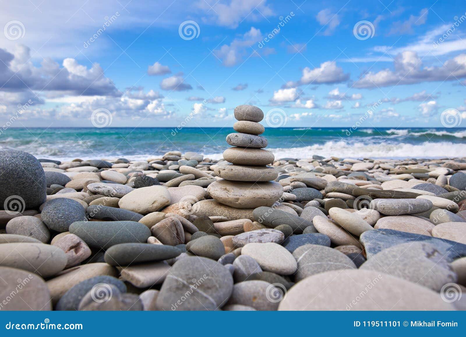Zen pyramid on the pebble beach