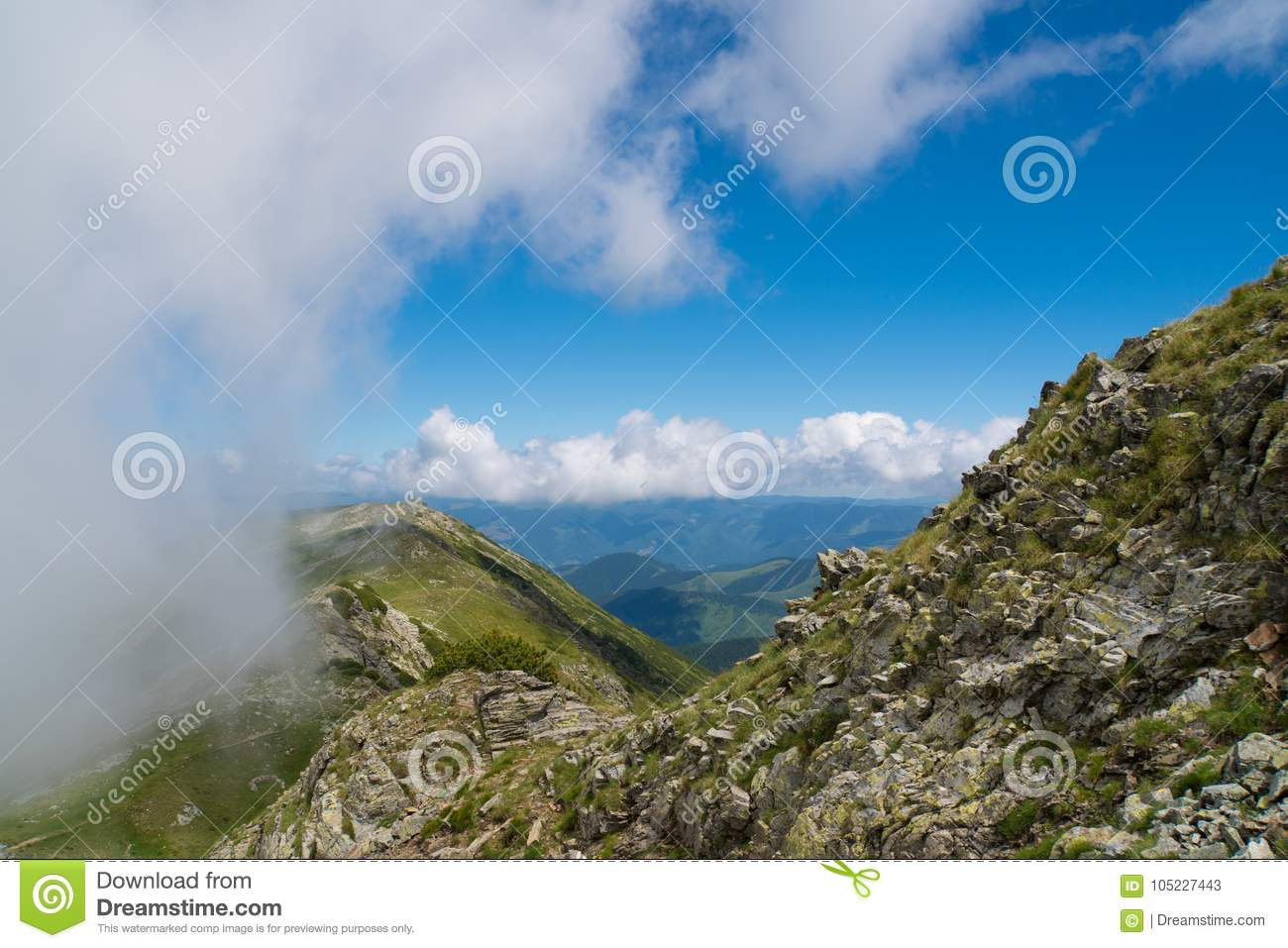 Beautiful wild landscape with rocky mountains and a beautiful summer sky