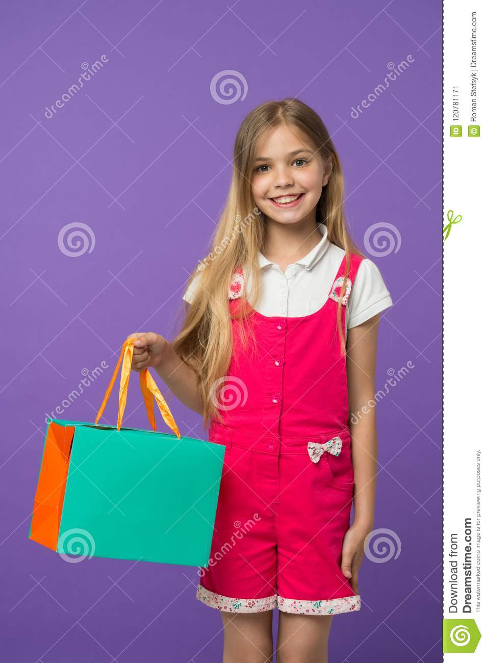 75eb8ed0a Summer sale. Girl cute teenager carries shopping bag. Kid bought clothing summer  sale.