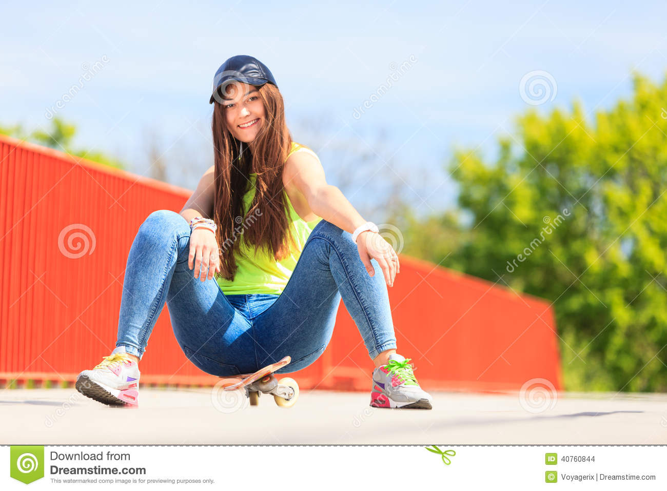 summer sport cool girl skater with skateboard stock photo