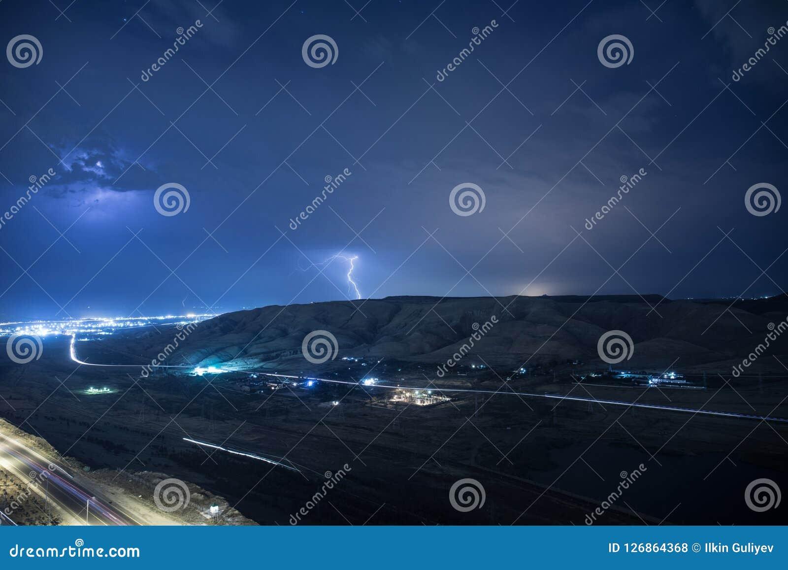 Summer storm bringing thunder, lightnings and rain. Baku. Azerbaijan Royalty Free Stock Photos
