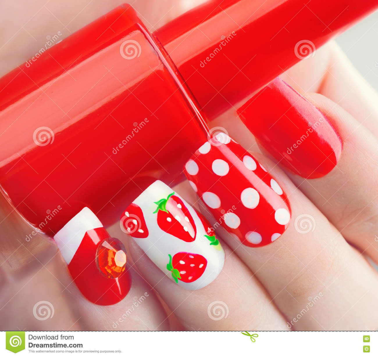 Summer style red manicure with strawberries and polka dots
