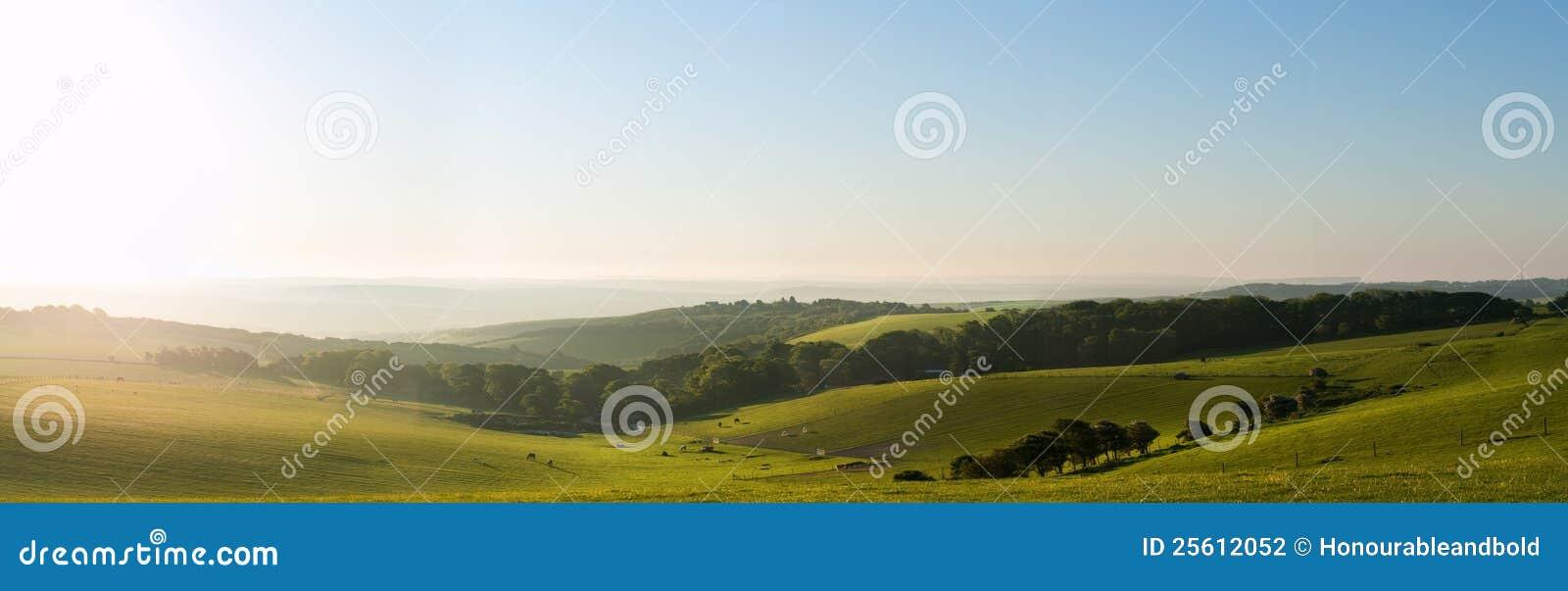Summer sunrise over English countryside landscape